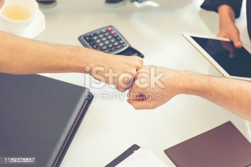 Business Partners Giving Fist Bump after complete a deal. Successful Teamwork with Hands Gesture. Fist Bump Colleagues Collaboration Teamwork. Partnership Business Concept.
