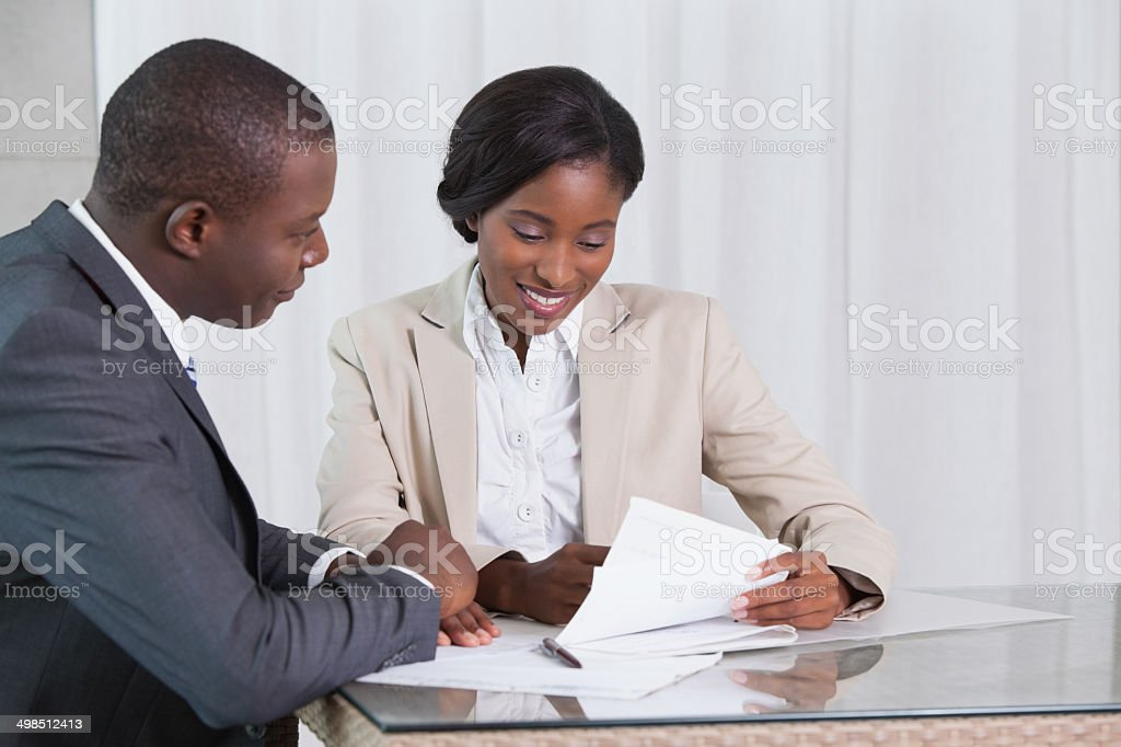 Business partners going over a contract together stock photo
