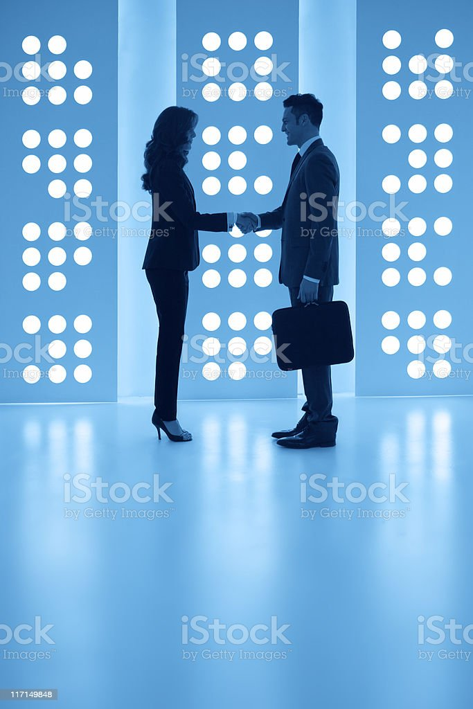 Business partners: handshake in a modern space royalty-free stock photo