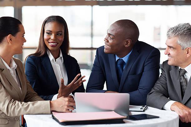 business partners having meeting stock photo