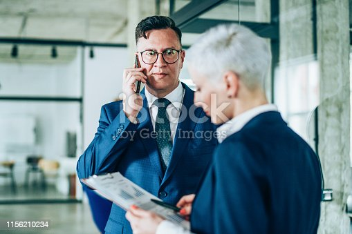 1157633068 istock photo Business partners in discussion 1156210234