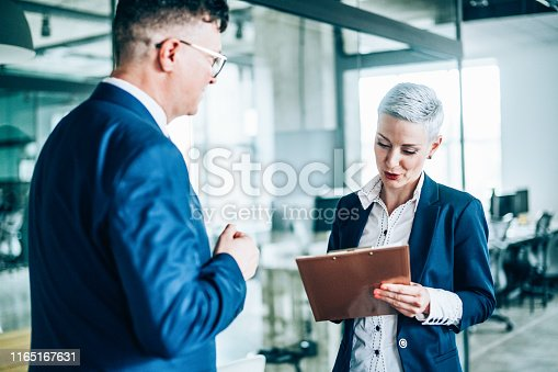 1157633068 istock photo Business partners in discussion 1165167631