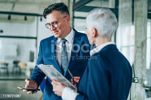 1157633068 istock photo Business partners in discussion 1176721087