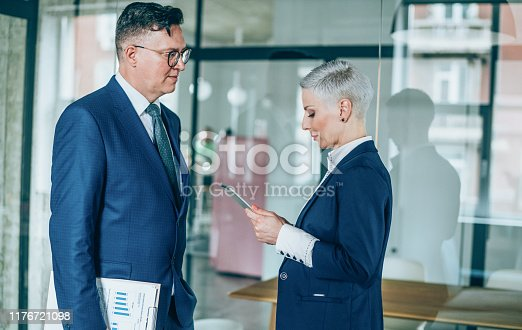 1157633068 istock photo Business partners in discussion 1176721098