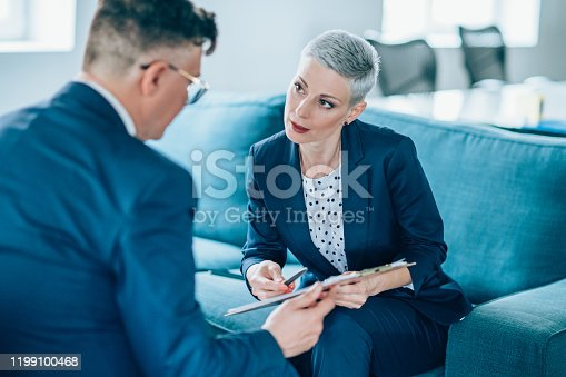 1157633068 istock photo Business partners in discussion 1199100468