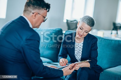 1157633068 istock photo Business partners in discussion 1220580235