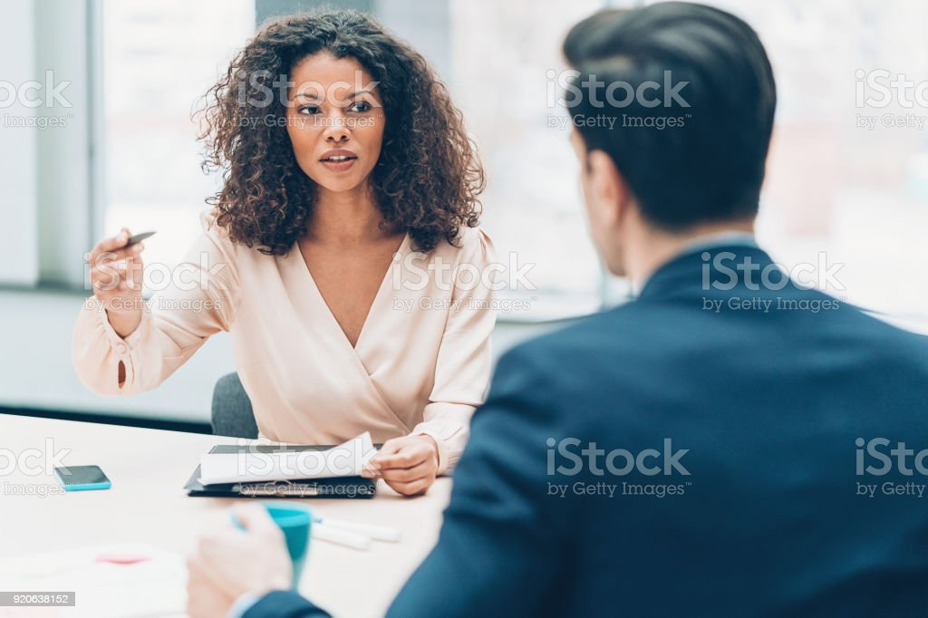 Business partners in discussion stock photo