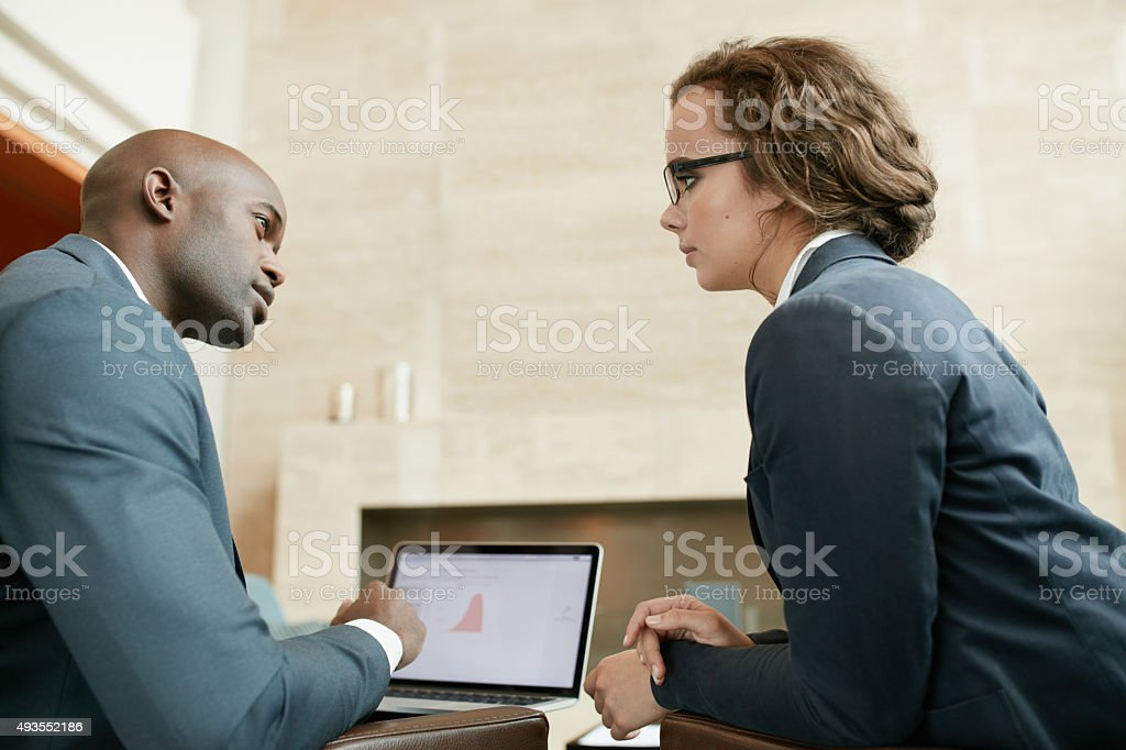 Business partners in serious discussions at restaurant stock photo