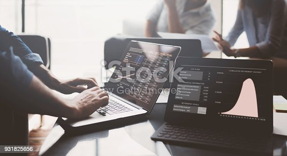 912617272 istock photo Business partners making research for new business direction.Young businessman working modern laptop.Business people meeting concept.Blurred background. 931825656