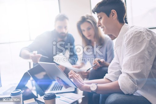 istock Business partners meeting concept.Coworkers team working new startup project at modern office.Analyze business documents, using touch tablet.Blurred background.Horizontal 907787834