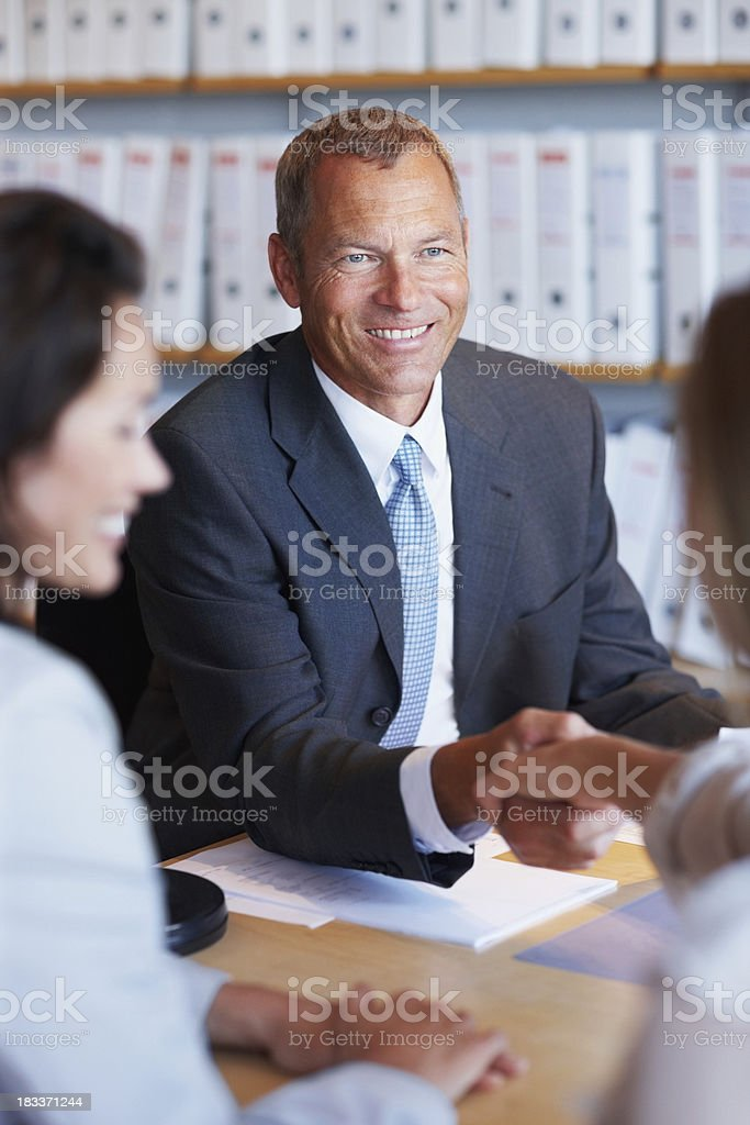 Business partners shaking hands on a contract royalty-free stock photo