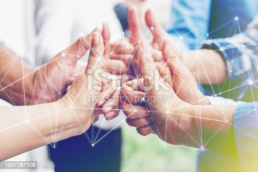 istock Business partners team achievement concept. Multi-ethnic diverse group of colleagues join hands together. Creative teamwork,business agreement. Important of teamwork. 1007287108