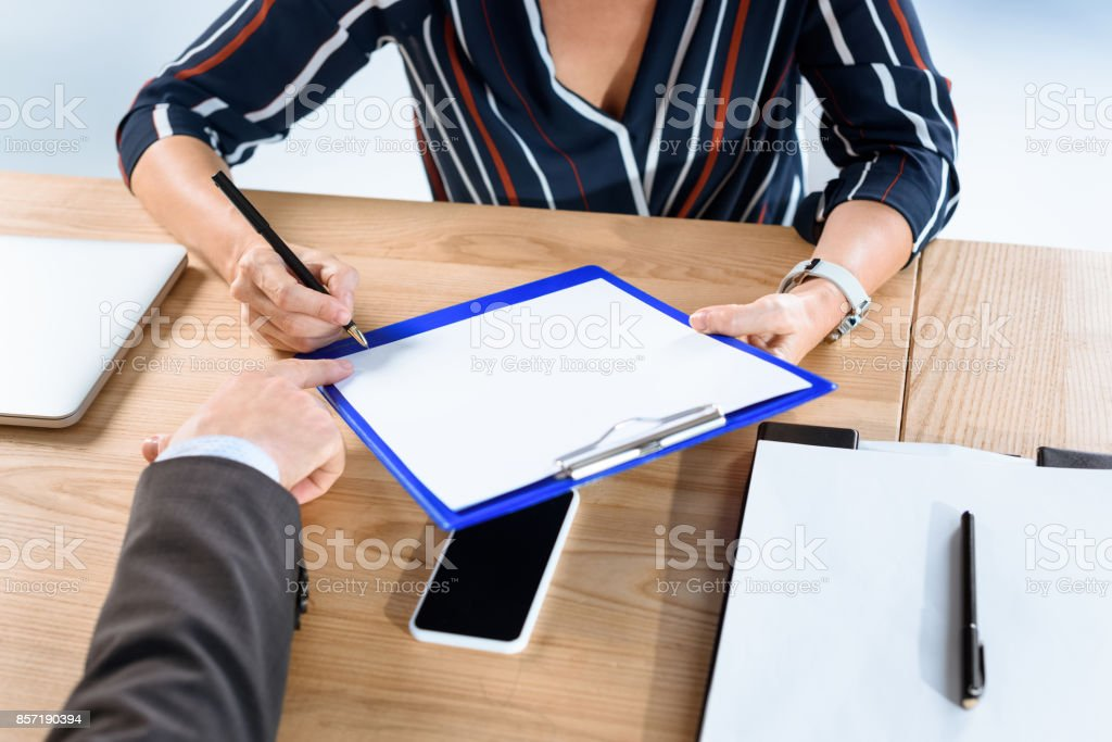 business partners writing contract stock photo