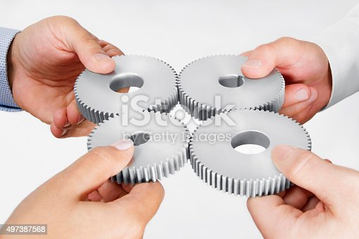 173706624istockphoto Business Partnership Concept with Cog Wheels 497387568