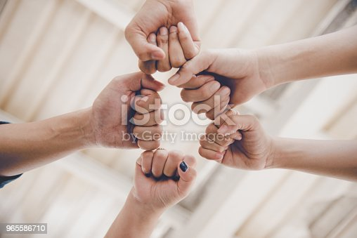 Business partnership giving fist bump to Start up new project. Business and Teamwork of Partnership concept. Corporation meeting in company or industrial work concept. selective focus on hand