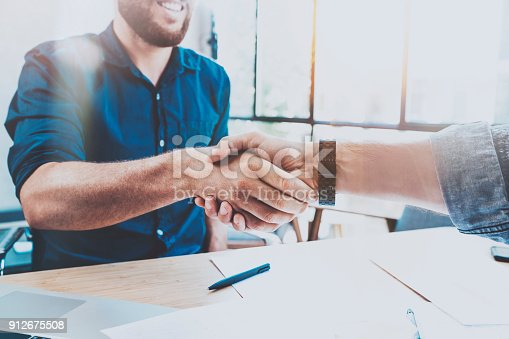 istock Business partnership handshake concept.Photo two businessman handshaking process.Successful deal after great meeting.Horizontal, blurred background. 912675508