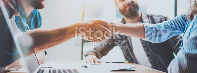 istock Business partnership handshake concept.Photo two coworkers handshaking process.Successful deal after great meeting.Horizontal, blurred background.Wide. 912680620