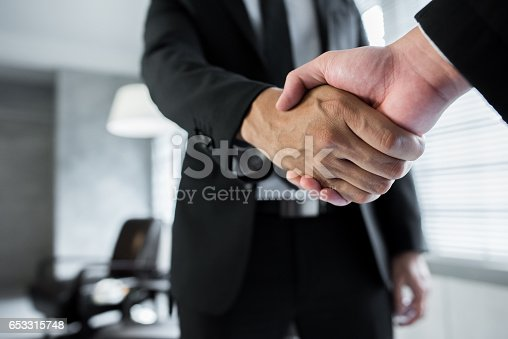 Businessmen seals a deal with a handshake.