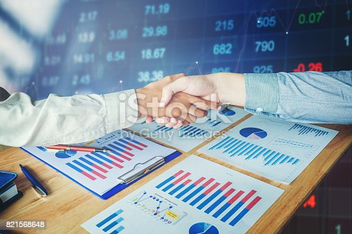 istock Business partnership meeting. businessmans handshake on stock financial exchange. Stock market financial indices 821568648