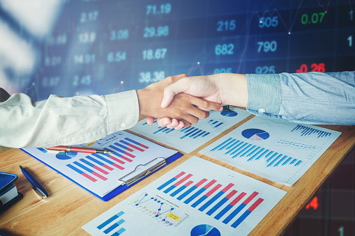687520174 istock photo Business partnership meeting. businessmans handshake on stock financial exchange. Stock market financial indices 821568648