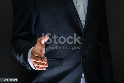 635949862 istock photo Business partnership meeting concept. Businessman handshake. Successful businessmen handshaking after good deal. Horizontal, blurred background 1046116906