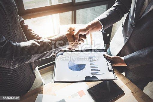 istock Business partnership meeting concept. Image businessmans handshake. Successful businessmen handshaking after good deal. Group support concept. 875090316