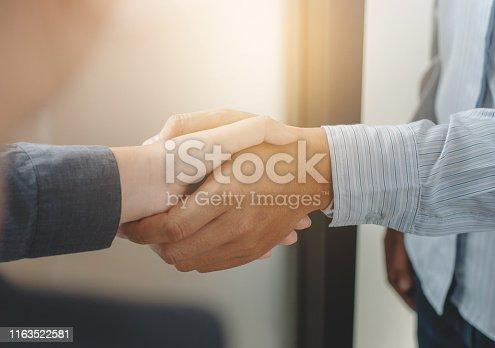 522304914 istock photo Business partnership meeting handshake in office room. 1163522581