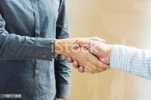 522304914 istock photo Business partnership meeting handshake in office room. 1169171828