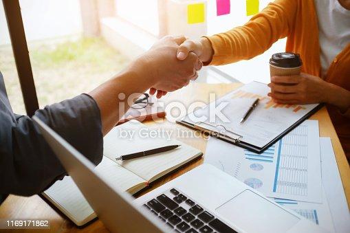 522304914 istock photo Business partnership meeting handshake in office room. 1169171862