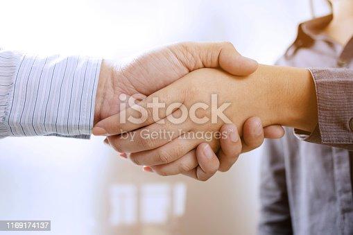 522304914 istock photo Business partnership meeting handshake in office room. 1169174137