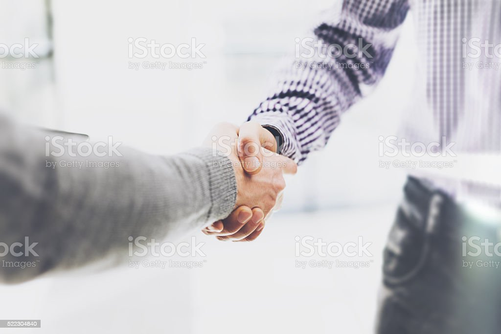 Business partnership meeting. Image businessmans handshake. Successful businessmen handshaking after stock photo