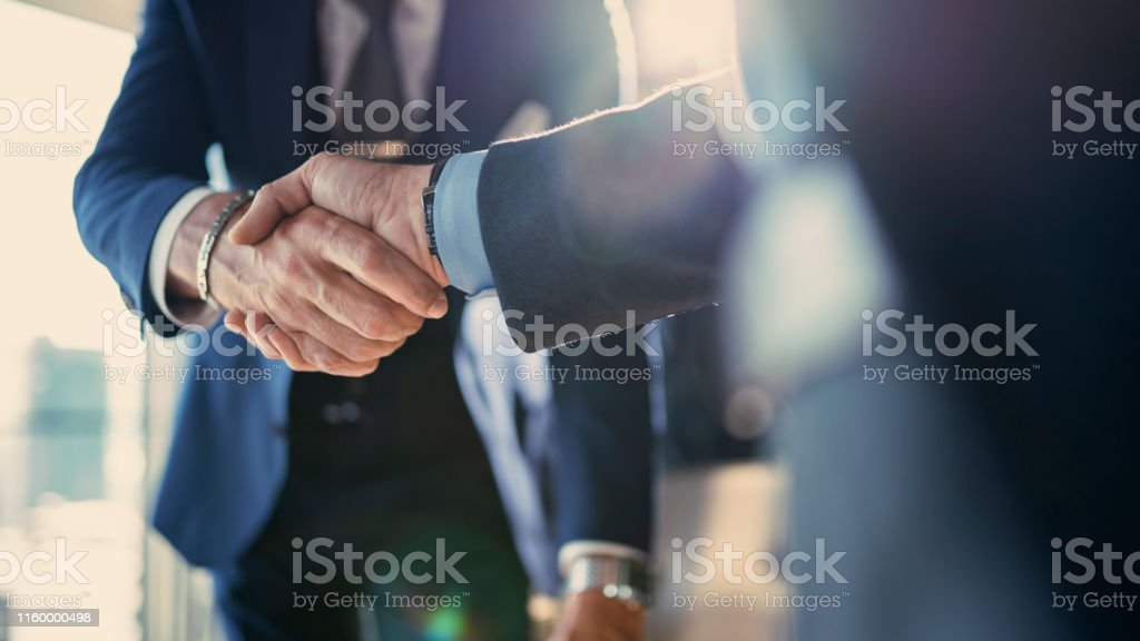 Business partnership meeting in office Business partnership meeting in office Adult Stock Photo