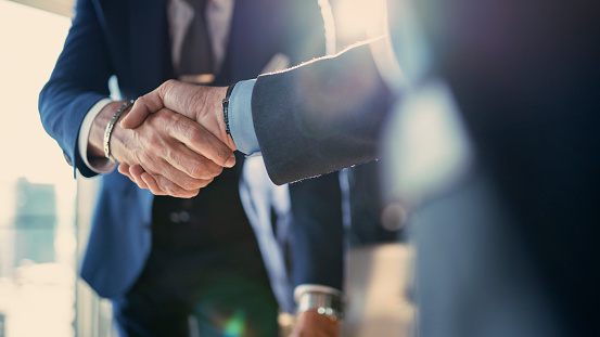 Business Partnership Meeting In Office Stock Photo - Download Image Now