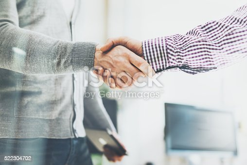 istock Business partnership meeting. Photo businessmans handshake. Successful businessmen handshaking after 522304702