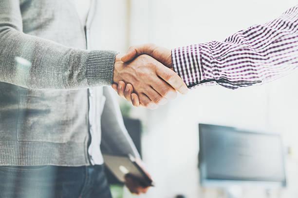 Business partnership meeting. Photo businessmans handshake. Successful businessmen handshaking after stock photo