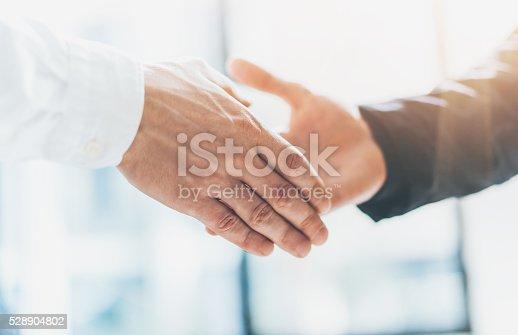 istock Business partnership meeting. Photo businessmans handshake. Successful businessmen handshaking after 528904802