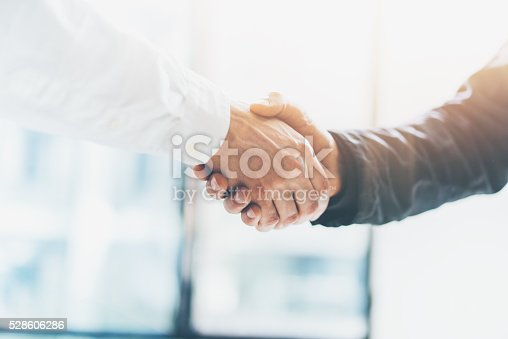 istock Business partnership meeting. Picture businessmans handshake. Successful businessmen handshaking after good deal. Horizontal, blurred 528606286