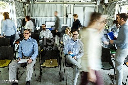istock Business people among their colleagues in blurred motion on a seminar. 1151768375