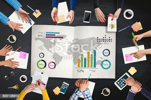 istock Business people analysis World map on table 655108910