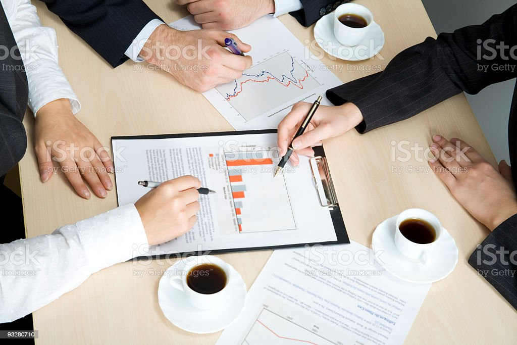 Business people analyzing data over coffee royalty-free stock photo