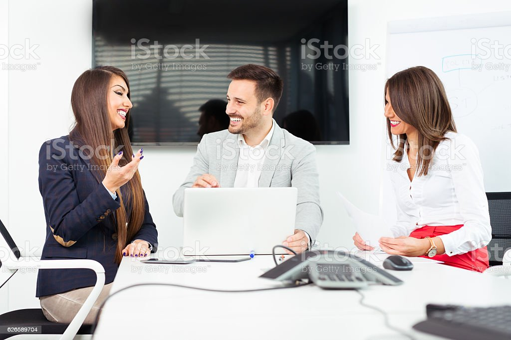 Business people analyzing documents stock photo