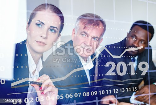 1186985932 istock photo Business people analyzing financial chart with a financial analyst 1089091236