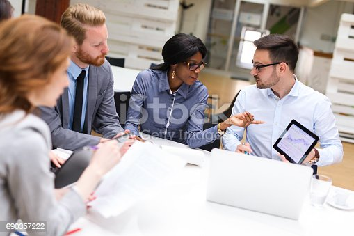 687687166 istock photo Business people analyzing financial chart with a financial analyst 690357222