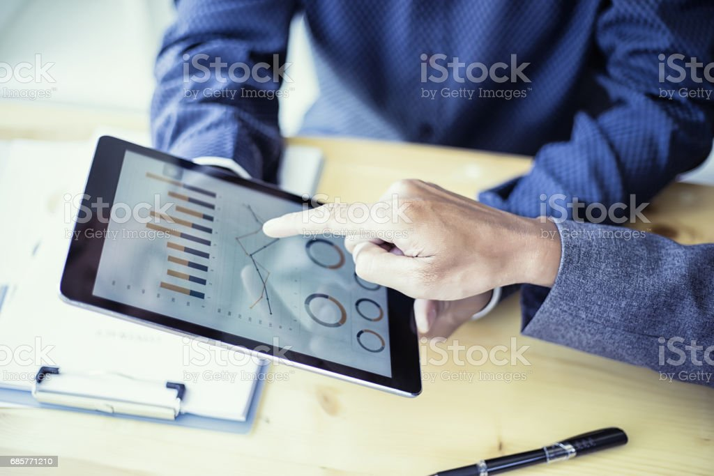 Business people analyzing investment charts on teblet in meeting room, Accounting concept - Photo