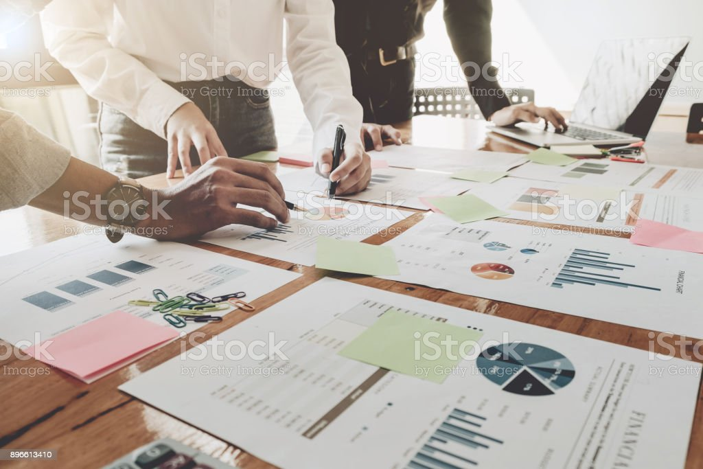 Business People Analyzing Statistics Business Documents,  Financial Concept stock photo