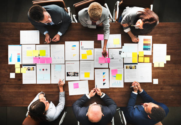 Business People Analyzing Statistics Financial Concept Business People Analyzing Statistics Financial Concept plan document stock pictures, royalty-free photos & images