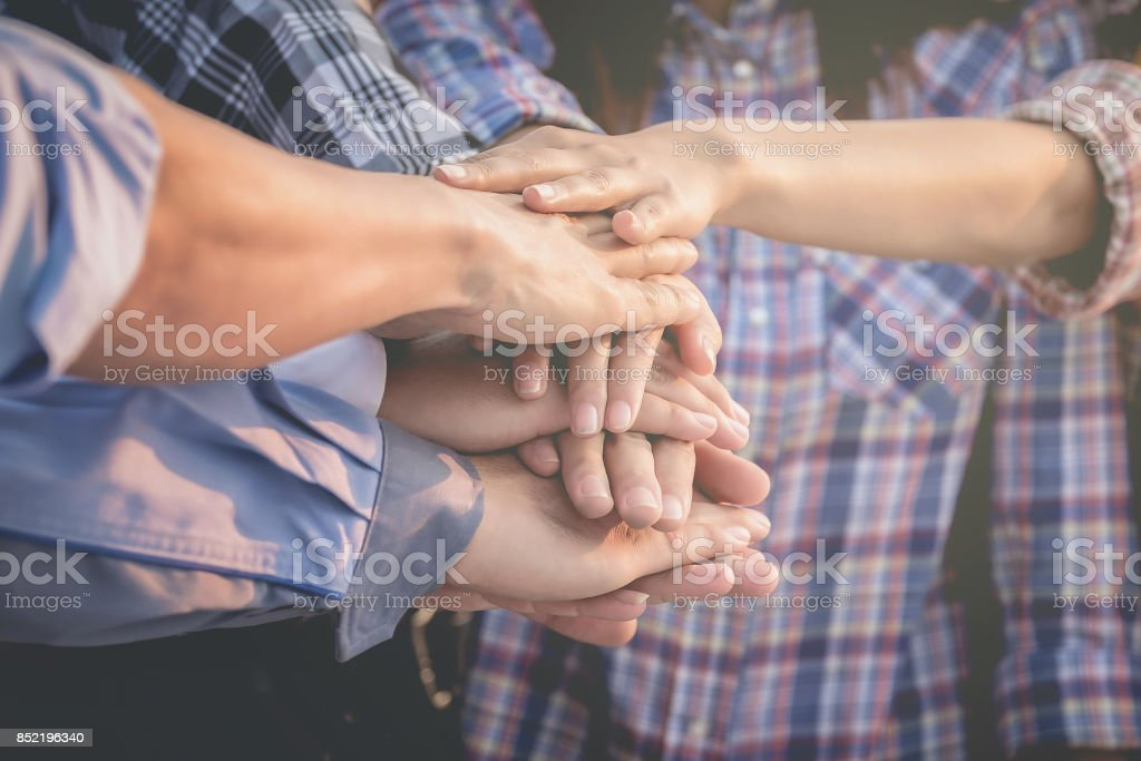 Business people and architects join hands for teamwork and unity and sustainability. stock photo
