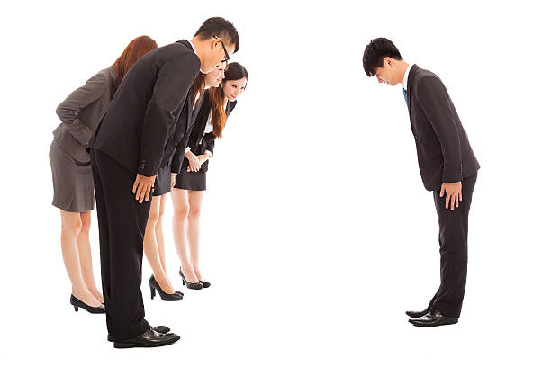 business people and boss with bow and scrape stock photo