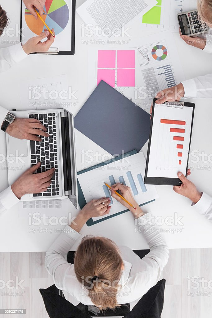 Business people and graphs royalty-free stock photo