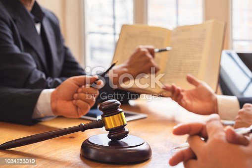 istock Business people and lawyer or judge team discussing Co-Investment Conference, Concepts of law, advice, legal services. 1034233010